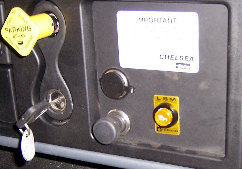 In- Cabin Warning and Manual Lubrication Button