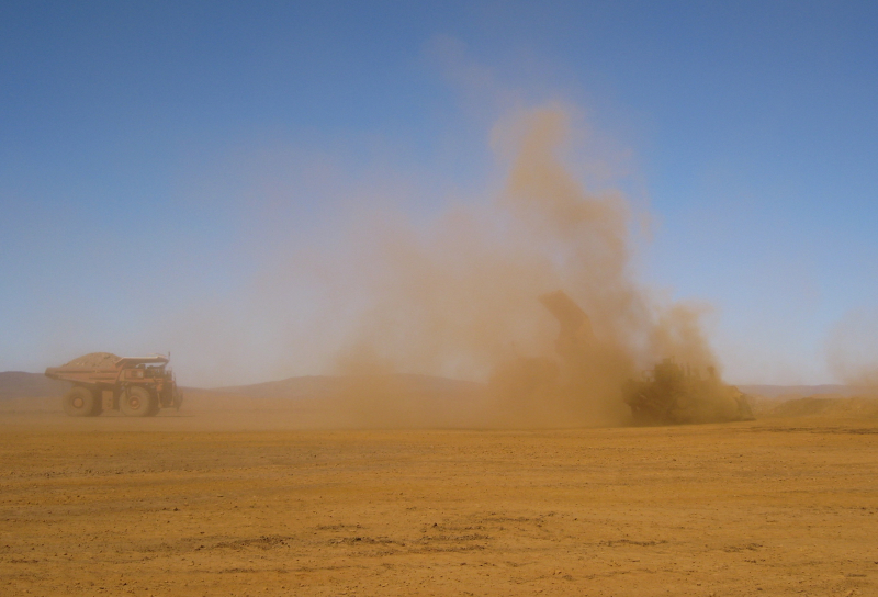 RESPA on Dozer- Dozer and 2 x Dump Trucks eveloped in dust